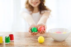 Close up of girl holding colored eggs Royalty Free Stock Photography