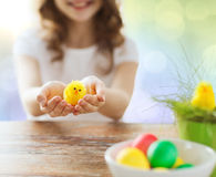 Close up of girl holding easter chicken toy Stock Photo