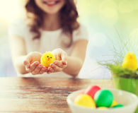 Close up of girl holding easter chicken toy Royalty Free Stock Photography