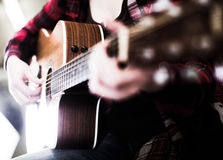 Close-up girl holding guitar. Royalty Free Stock Images