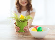 Close up of girl holding pot with green grass Stock Photos