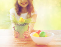 Close up of girl holding pot with toy chicken Royalty Free Stock Photography