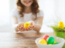 Close up of girl holding yellow chiken toy Stock Image