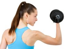 Close up of girl lifting weight. Stock Photos