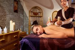 Close-up of a girl massage with bags in spa salon.  Stock Photos