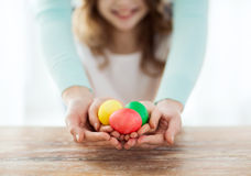 Close up of girl and mother holding colored eggs Royalty Free Stock Images