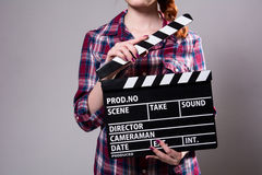 Close-up of a girl with a movie clapper Royalty Free Stock Photography