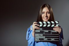 Close-up of a girl with a movie clapper Stock Photo