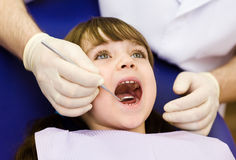 Close-up of  girl opening his mouth wide during inspection Royalty Free Stock Photography