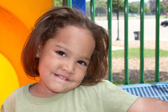 Close up of girl outside. Close-up portrait of a cute african-american girl outside at the park Royalty Free Stock Images