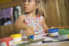 Close-up of a girl painting with her finger Royalty Free Stock Photos