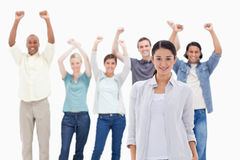 Close-up of a girl with people raising their arms Stock Images