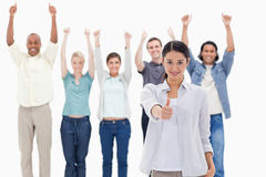 Close-up of a girl with people raising their arms and with their Royalty Free Stock Image