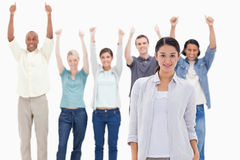 Close-up of a girl with people raising their arms with their thu Royalty Free Stock Photography