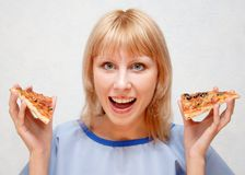 Close-up of a girl with the pizza. Royalty Free Stock Image
