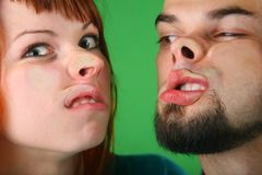 Close up girl with red hair and guy grimace mash Stock Photo