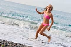 Close-up girl running on beach Stock Photo