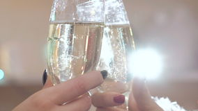 Close up of girl's hands toasting with bocals of champagne. Slowly stock video