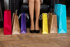 Close up of girl's legs in heels and buyings. Close up photo of girl's legs in heels and buyings royalty free stock image
