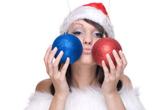 Close up girl in santa dress and decoration balls Royalty Free Stock Image