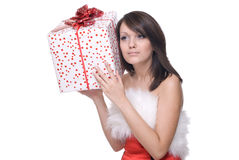 Close up of girl in santa dress with gifts. Close up portrait of emotional girl in santa claus dress, white fur and some gifts Stock Image