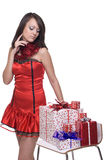 Close up of girl in santa dress with gifts. Close up portrait of emotional girl in santa claus dress, white fur and some gifts Royalty Free Stock Image