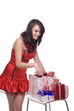 Close up of girl in santa dress with gifts. Close up portrait of emotional girl in santa claus dress, white fur and some gifts royalty free stock images