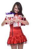 Close up girl in santa dress with gifts. Close up portrait of emotional girl in santa claus dress, white fur and some gifts Royalty Free Stock Photo