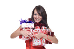 Close up girl in santa dress with gifts. Close up portrait of emotional girl in santa claus dress, white fur and some gifts Stock Photography