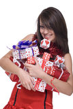 Close up girl in santa dress with gifts. Close up portrait of emotional girl in santa claus dress, white fur and some gifts Royalty Free Stock Images