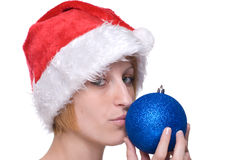 Close up girl in santa hat kiss decoration ball Royalty Free Stock Image