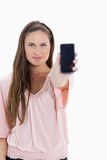 Close-up of a girl showing a smartphone Stock Photo