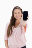 Close-up of a girl showing a smartphone screen Royalty Free Stock Photography