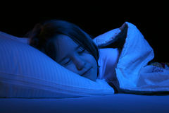 Close up of girl sleeping on pillow Stock Photography