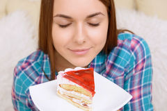 Close-up of girl smelling cake Royalty Free Stock Photos