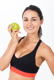 Close up of girl in sport bra with an apple Stock Photo
