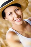 Close up of girl in straw hat against rye field Stock Photos