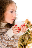 Close-up girl in a sweater with a mug Royalty Free Stock Photography
