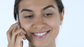 Close up of Girl Talking on Phone, White Background in Studio Royalty Free Stock Images