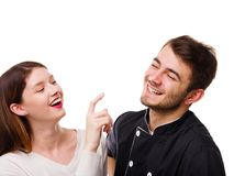 Close-up of a girl touching her boyfriend`s nose with a forefinger royalty free stock photo