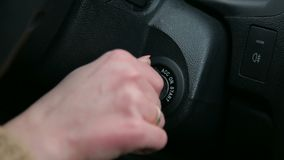 Close-up of the girl turns the ignition key in car. Close-up of the girl turns the ignition key in the car stock footage