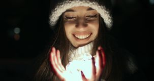 Girl Unfolding Hands filled with Small Decoration Lights. Close Up of Girl Unfolding Hands filled with Small Decoration Lights in Dark stock video
