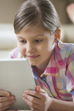 Close-up of girl using digital tablet at home Royalty Free Stock Image