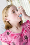 Close up of girl using inhaler Stock Photo