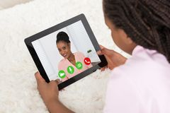 Girl Video Conferencing With Her Mother Stock Photos