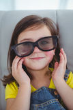Close up of a girl wearing 3d glasses for a moive Royalty Free Stock Image