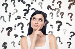 Close up of a girl in white tank top and question marks Stock Photos