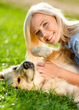 Close up of girl who strokes retriever Royalty Free Stock Photos