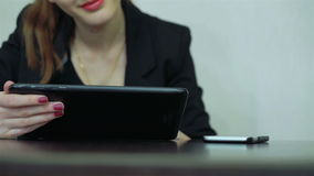 Close-up. Girl works with the tablet. Woman using tablet computer. Business office stock video