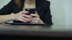 Close-up. Girl works with the tablet. Woman using tablet computer. Business office stock footage